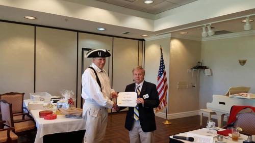 President Jim Grayshaw presents certificate Feb 2019