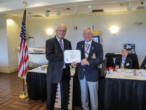 Dr. David Leonard receiving SAR membership certificate