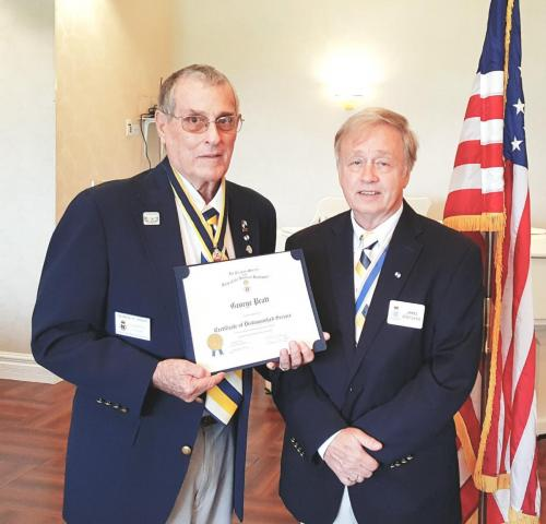 George Pratt receives Dist. Service Cert from Pres. Jim Grayshaw at October luncheon