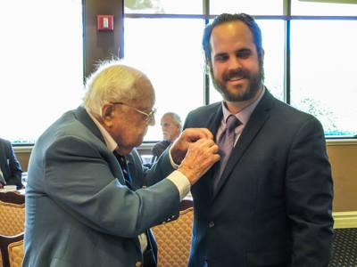 Hal Miller pinning SAR rosette on his grandson Jonathan Vincent