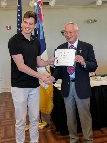 Sami Vanni receiving certificate of appreciation